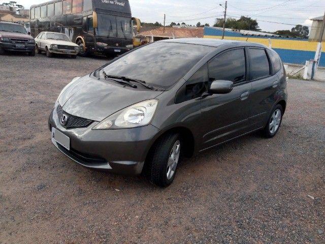 Honda Fit lxl flex 1.4 101cv cambio manual , dir hid, ar cond abs air bag  2010 - Foto 6