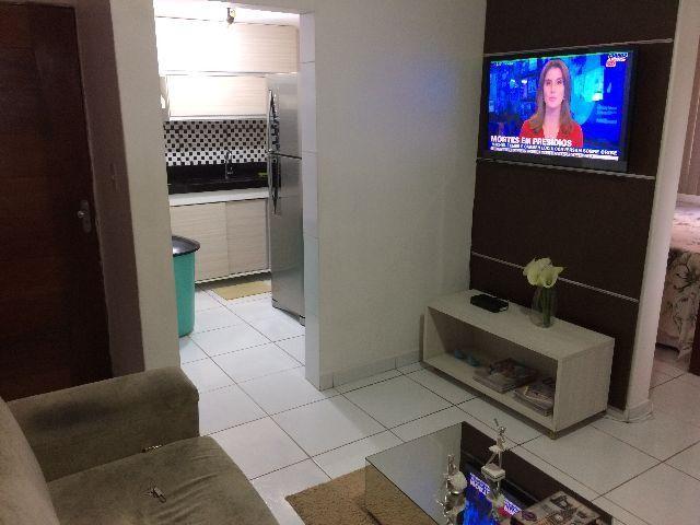 Apartamento com móveis projetados