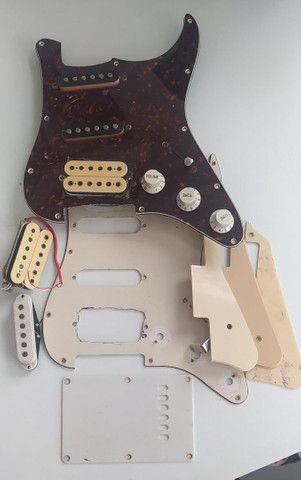 Escudos e captadores de guitarra