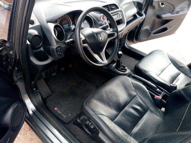 Honda Fit lxl flex 1.4 101cv cambio manual , dir hid, ar cond abs air bag  2010 - Foto 14
