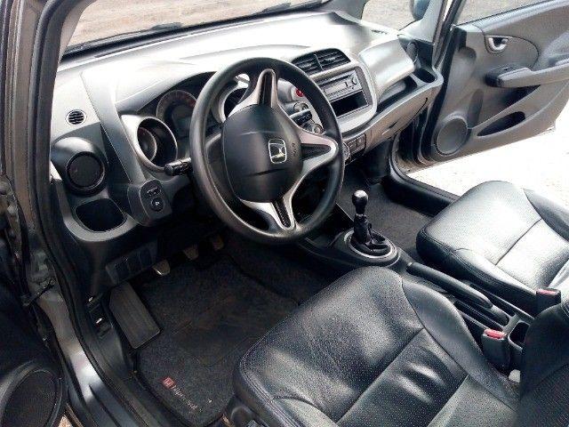 Honda Fit lxl flex 1.4 101cv cambio manual , dir hid, ar cond abs air bag  2010 - Foto 15