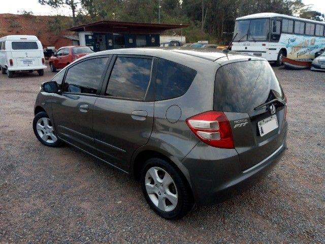 Honda Fit lxl flex 1.4 101cv cambio manual , dir hid, ar cond abs air bag  2010 - Foto 5