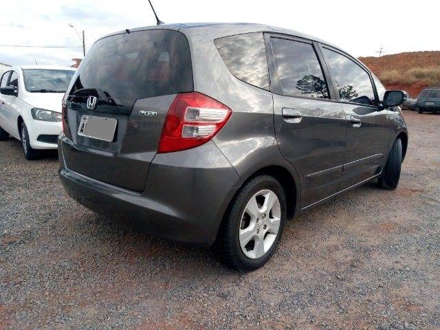 Honda Fit lxl flex 1.4 101cv cambio manual , dir hid, ar cond abs air bag  2010 - Foto 9