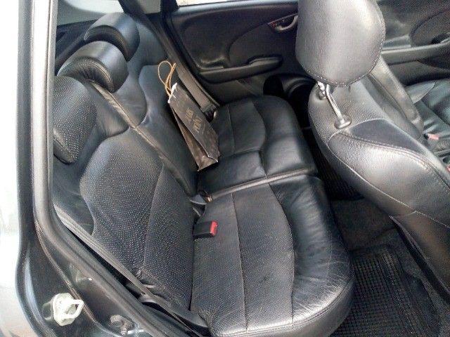 Honda Fit lxl flex 1.4 101cv cambio manual , dir hid, ar cond abs air bag  2010 - Foto 19