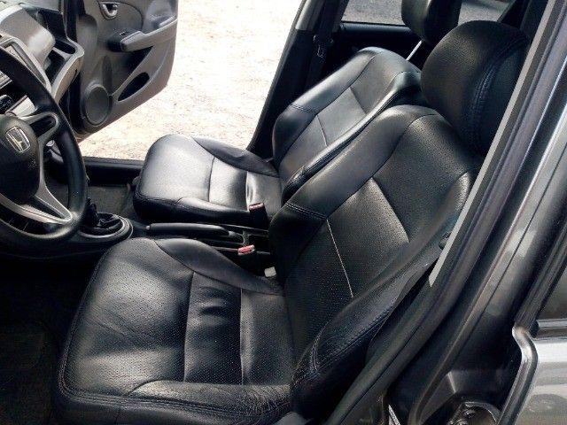 Honda Fit lxl flex 1.4 101cv cambio manual , dir hid, ar cond abs air bag  2010 - Foto 18