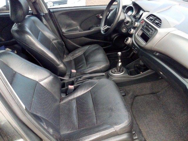 Honda Fit lxl flex 1.4 101cv cambio manual , dir hid, ar cond abs air bag  2010 - Foto 20