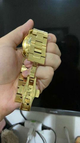 Vendo relogio movado bold dourado  - Foto 4