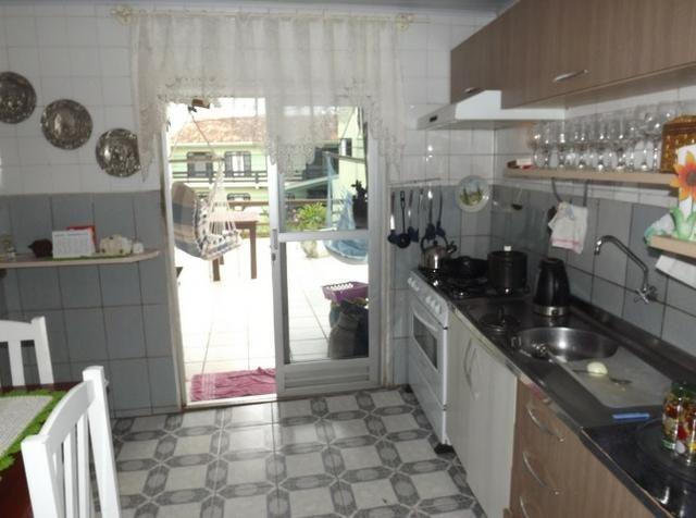 Sobrado central na Praia c/ 03 suítes mais 04 dormitórios! Ideal para aluguel de quartos - Foto 9