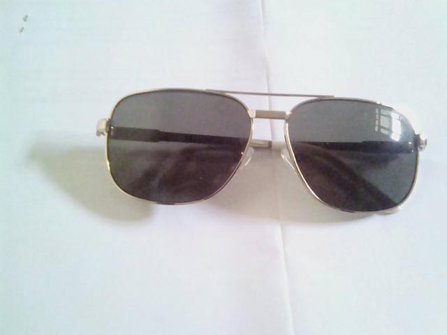 Óculos de sol original aceito troca