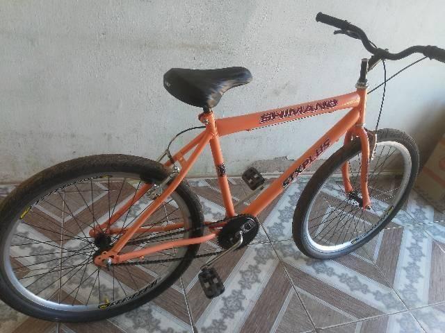 Vendo essa bike semi nova aro 26 - Foto 2