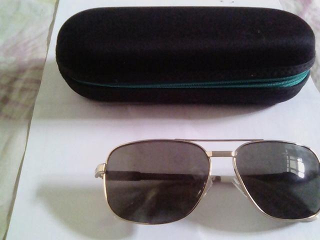 Óculos de sol original aceito troca - Foto 3