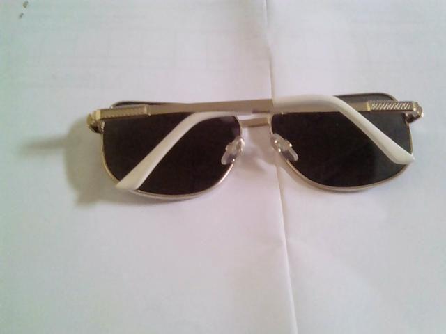 Óculos de sol original aceito troca - Foto 2