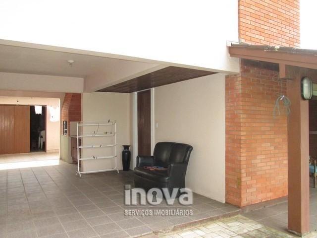 Casa de 04 dormitórios no centro de Imbé - Foto 2