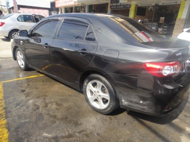 Toyota Corolla Financio ate sem entrada+gnv d quint ger+ completo troca moto ou carro - Foto 17