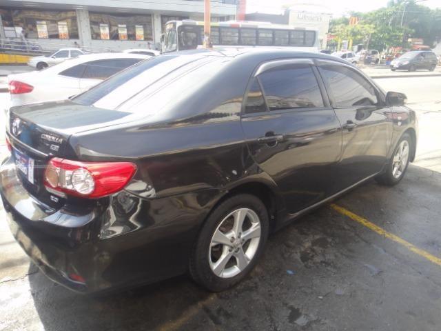 Toyota Corolla Financio ate sem entrada+gnv d quint ger+ completo troca moto ou carro - Foto 6