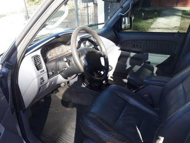 Toyota Hilux SW4 7 Lugares Turbo Diesel 4X4 - Foto 9