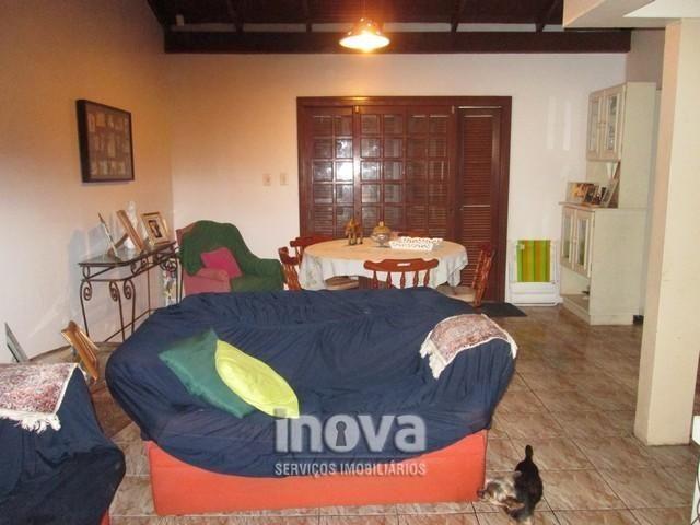 Casa de 04 dormitórios no centro de Imbé - Foto 4