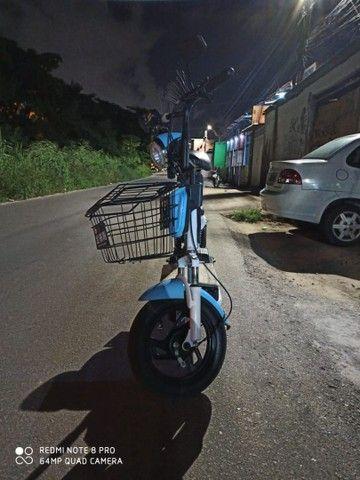 Bicicleta elétrica com autonomia de 50 a 60 KM e carregado na tomada. - Foto 3