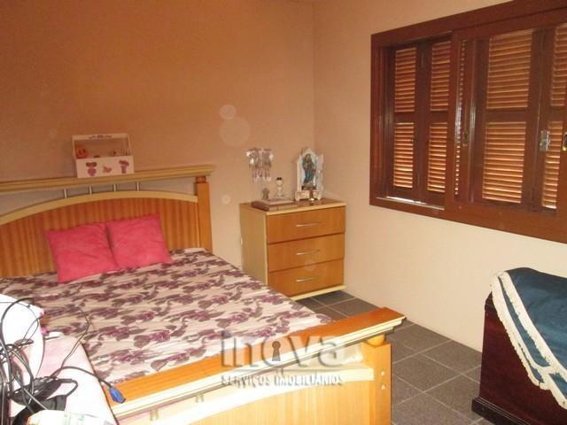 Casa de 04 dormitórios no centro de Imbé - Foto 14
