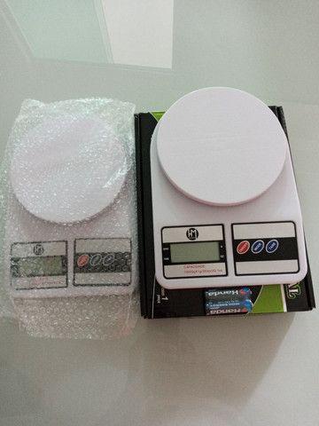 Balança digital até 10 kilos.