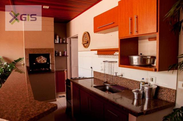 Imóvel Lindo. Casa com 4 dormitórios. Área Gourmet com piscina. Excelente Localização. - Foto 17