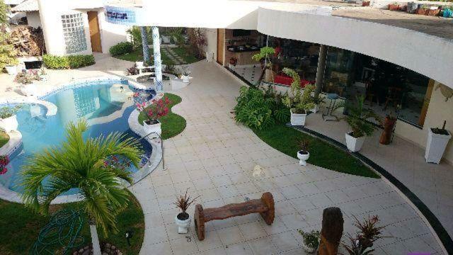 Casa 4 quartos(suítes), 2 DCE, piscina, área gourmet, sauna, banheira, no Laguna