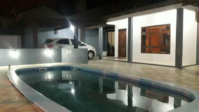 Casa com piscina em Atlântida Sul - Foto 7