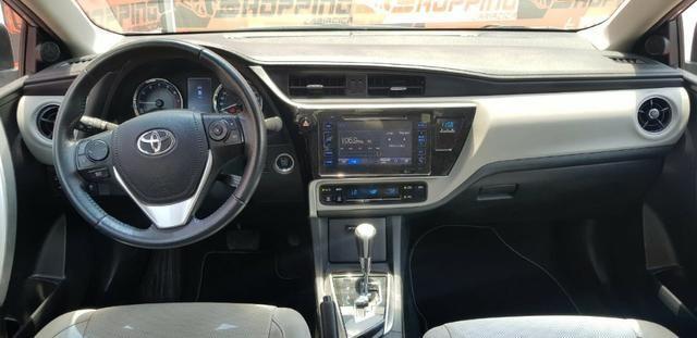 Toyota Corolla XEi automático promocao troco por moto - Foto 3