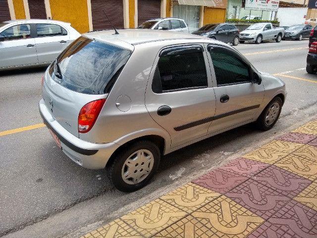 Celta 4 portas ar condicionado com manual chave reserva único dono - Foto 3