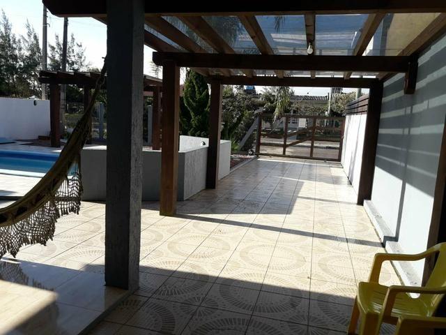 Casa com piscina em Atlântida Sul - Foto 9