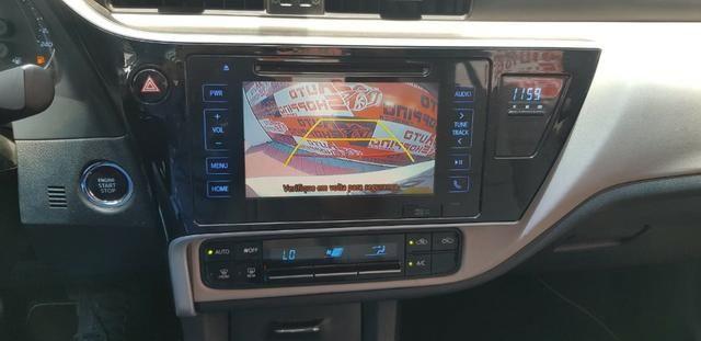 Toyota Corolla XEi automático promocao troco por moto - Foto 5
