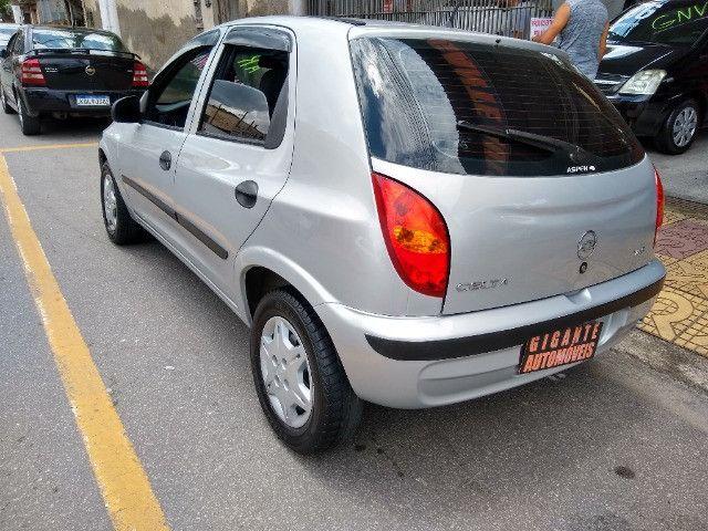 Celta 4 portas ar condicionado com manual chave reserva único dono - Foto 2