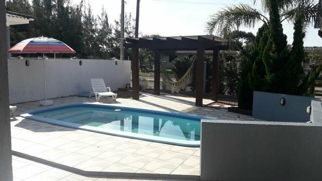 Casa com piscina em Atlântida Sul - Foto 8