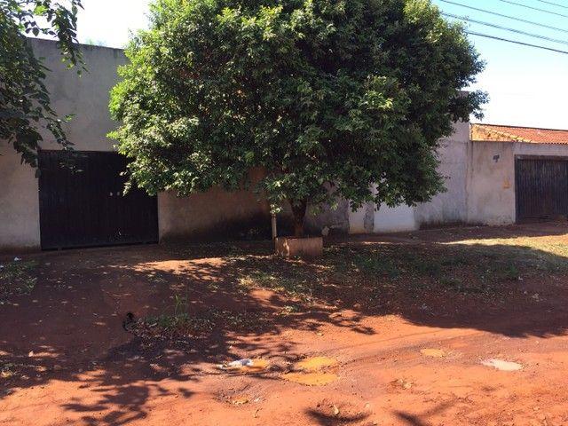 Terreno contendo 2 casas e 1 salão comercial