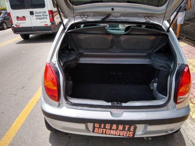 Celta 4 portas ar condicionado com manual chave reserva único dono - Foto 5