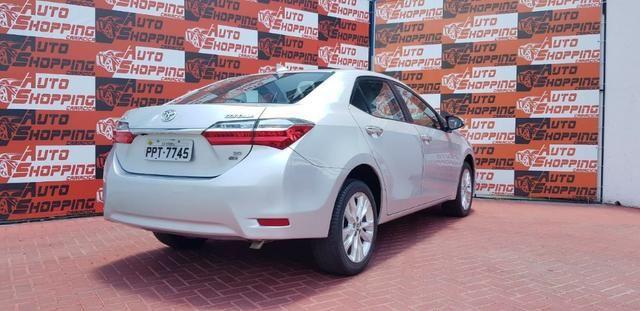 Toyota Corolla XEi automático promocao troco por moto - Foto 9