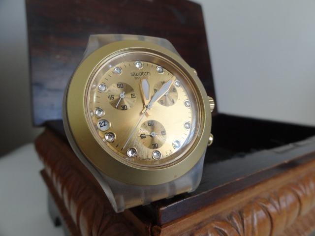 7fe57c3468f Relógio Swatch dourado (modelo Full-blooded) - usado - Bijouterias ...