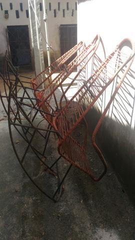 Cadeiras de ferro de balanço
