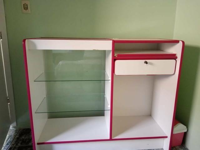 Balcão caixa de loja e provador cortina rosa