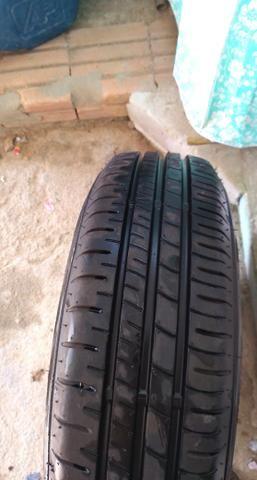 Vendo 4 rodas liga leve e 4 pneus Dunlop zerados - Foto 2