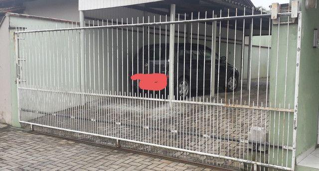 Portão e cerca de ferro