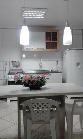 Alugo apartamento no centro de Torres com garagem e ar condicionado