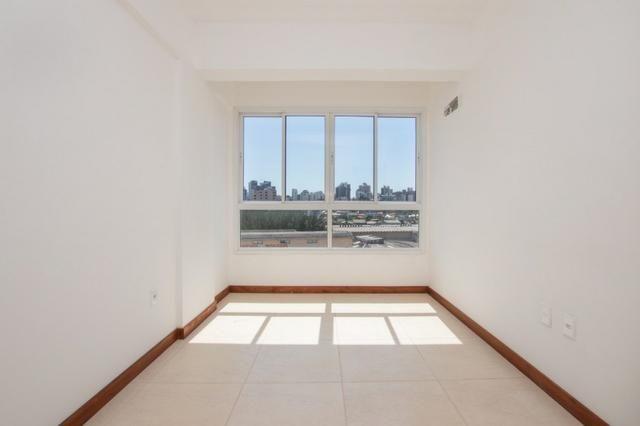 Apartamento novo em Torres de três dormitórios sendo um suíte - Foto 7
