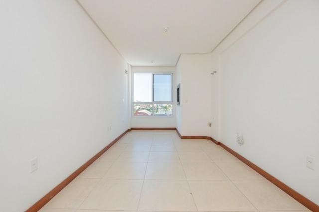 Apartamento novo em Torres de três dormitórios sendo um suíte - Foto 6