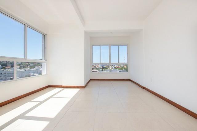 Apartamento novo em Torres de três dormitórios sendo um suíte - Foto 3