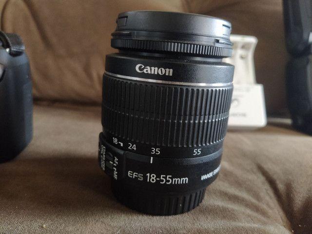 Camera Canon t6 semi nova com lente 18.55 mais 50mm flash youngnou  - Foto 3