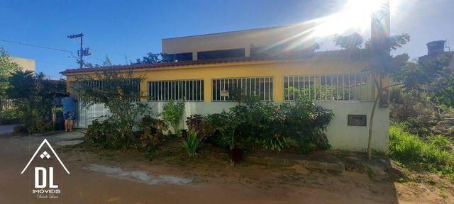 Casa com terraço e escritura