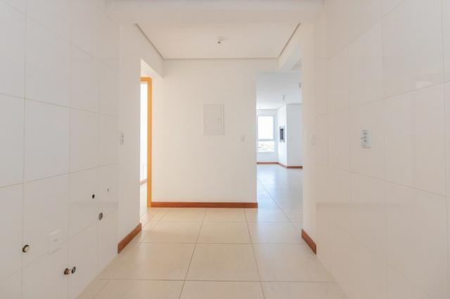 Apartamento novo em Torres de três dormitórios sendo um suíte - Foto 4