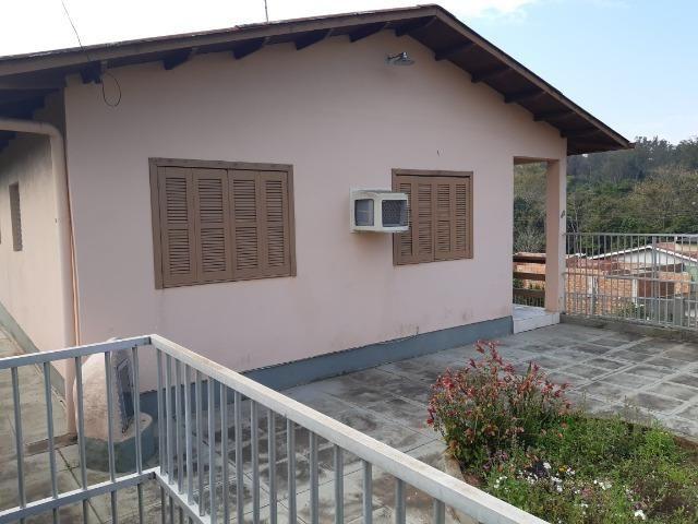 Casa 3 dormitórios no bairro Califórnia em Nova Santa Rita - Foto 2