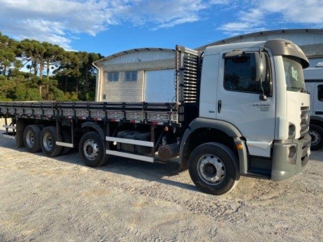 Vw-24.280 ano:13,branco,bi-Truck 8x2,com carroceria de 9 mts,ótimo estado. - Foto 11